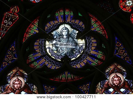 VIENNA, AUSTRIA - OCTOBER 11: Saint Matthew the Evangelist, Stained glass in Votiv Kirche (The Votive Church). It is a neo-Gothic church in Vienna, Austria on October 11, 2014