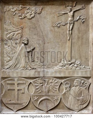 VIENNA, AUSTRIA - OCTOBER 10: An old crucifixion relief sculpture outside St. Stephens Cathedral in Vienna, Austria on October 10, 2014