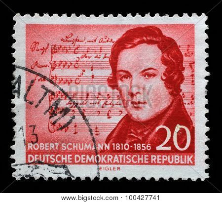 GERMAN DEMOCRATIC REPUBLIC - CIRCA 1956: A stamp printed in GDR shows Robert Schumann (1810-1856), (Music by Schubert), composer, centenary of the death, circa 1956