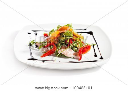 Salad with Sliced Salmon, Rucola and Paprika