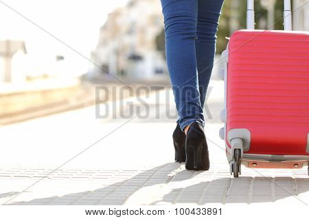 Traveler Legs Walking With Luggage In A Train Station