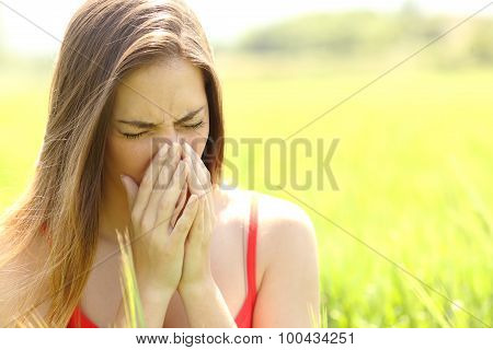 Woman With Allergy Coughing In A Field