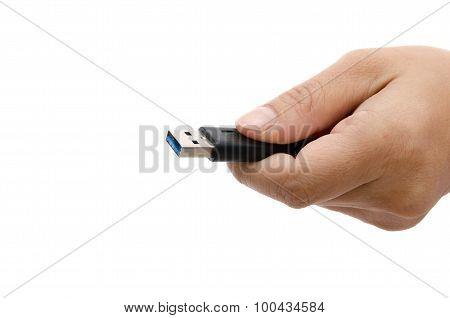 Hand Holding Black Usb Data Storage