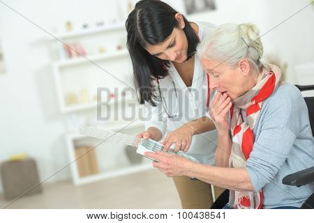Doctor showing patient her medication