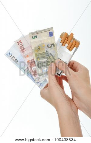 Holding cigarettes and money