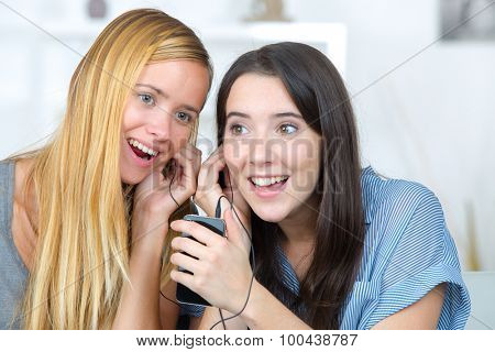 Female friends listening to music