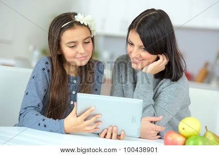 Mother and daughter using a tablet computer