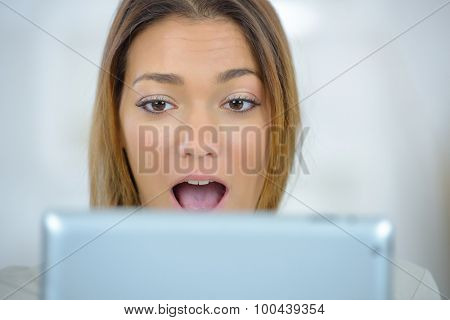 Surprised woman on computer