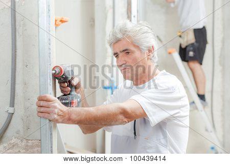 Mason using a drill
