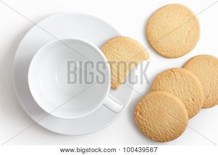 Empty White Cup And Saucer With Shortbread Biscuits From Above.