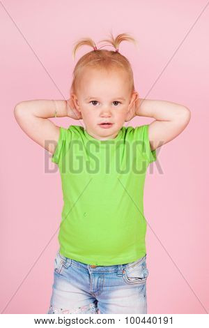 Portrait toddler girl on pink background