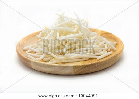 Cutting bean sprouts on wooden disk, white background