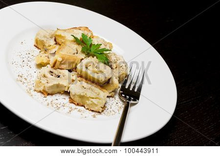 Close-up Of Dish Of Italian Swivels Pasta With Porcini Mushrooms And Sauce Bechamel With Pepper Near
