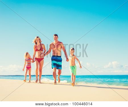 Family vacation. Happy family having fun on beautiful warm sunny beach. Summer lifestyle