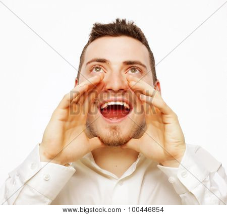 people, business and lifestyle concept -  handsome businessman in white shirt  shouting while looking at camera and standing against white background