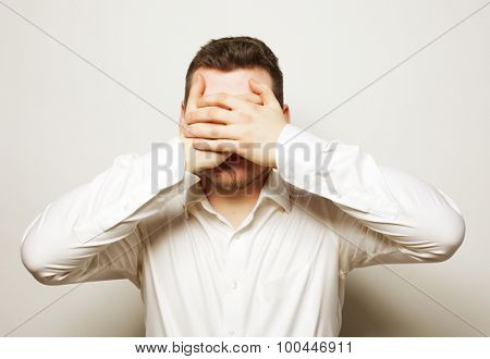 business, success and people concept - young  business man cover eyes with his hands, white shirt, studio shoot isolated on white