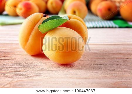 Ripe apricots on wooden table, closeup