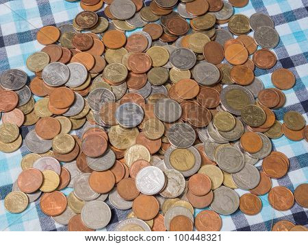 Pile Of Disrupted Coins Baht Currency On The Loincloth Silk Background.