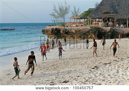 African Teenagers Playing Beach Football On Shores Of Indian Ocean.