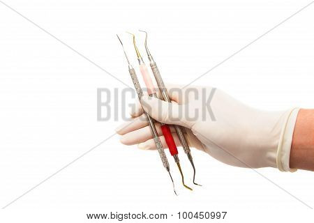 Dentist  Grapping  Dental Tool On White Background
