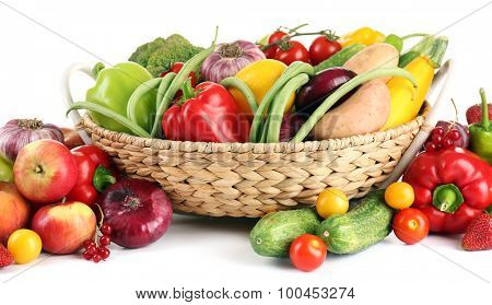 Heap of fresh fruits and vegetables  in basket close up