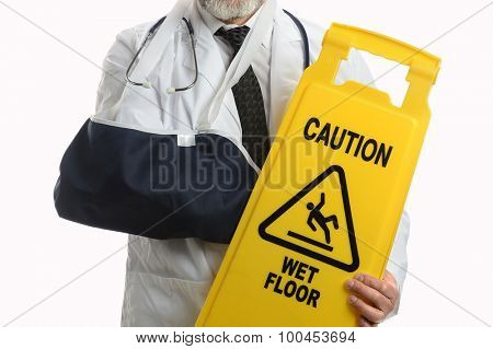 Doctor holding caution sign and wearing elbow sling isolated over white background