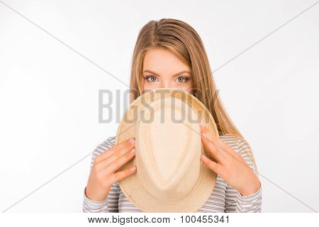 Beautiful Shy Girl Hiding Her Face Behind Her Hat