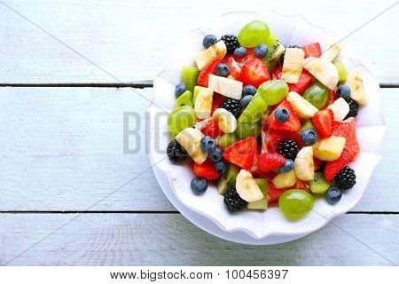 Fresh fruit salad on wooden table