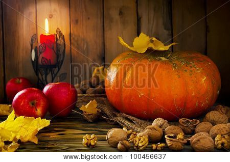 Thanksgiving - Pumpkin, Nuts, Apples With Candlelight