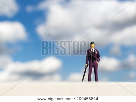 Business Man Miniature Model And Cloudy Sky