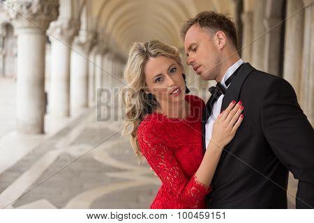 Elegantly dressed passionate couple