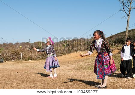 H'mong ethnic minority girls play traditional game with tenis ball in Mocchau, V