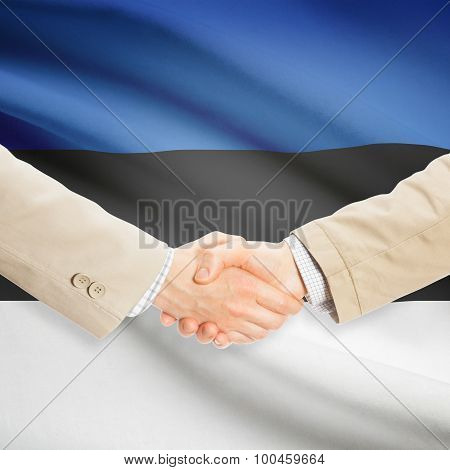 Businessmen Handshake With Flag On Background - Estonia