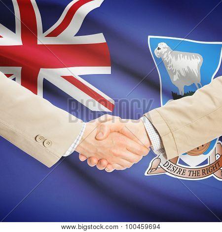 Businessmen Handshake With Flag On Background - Falkland Islands