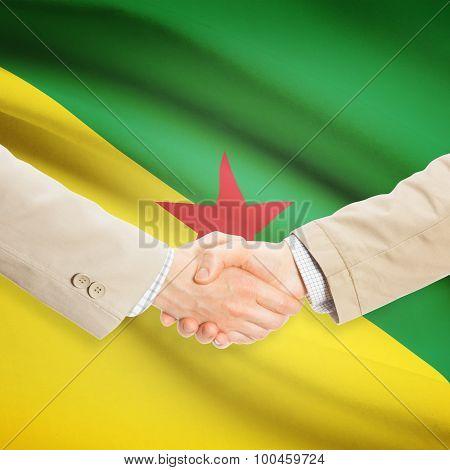 Businessmen Handshake With Flag On Background - French Guiana