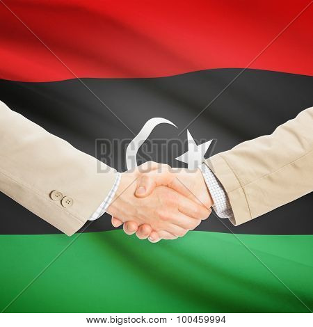 Businessmen Handshake With Flag On Background - Libya