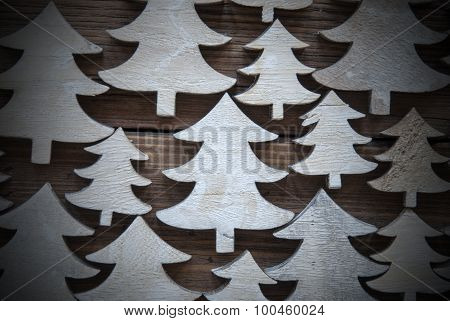 Close Up Of Christmas Trees On Wood With Frame