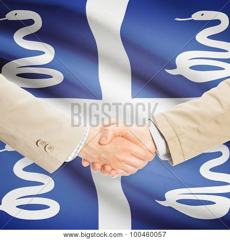 Businessmen Handshake With Flag On Background - Martinique