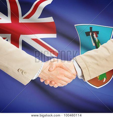 Businessmen Handshake With Flag On Background - Montserrat