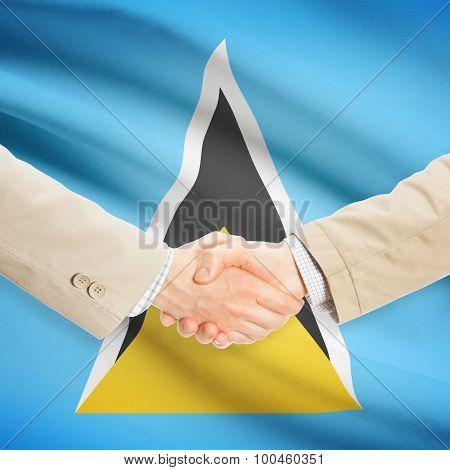 Businessmen Handshake With Flag On Background - Saint Lucia