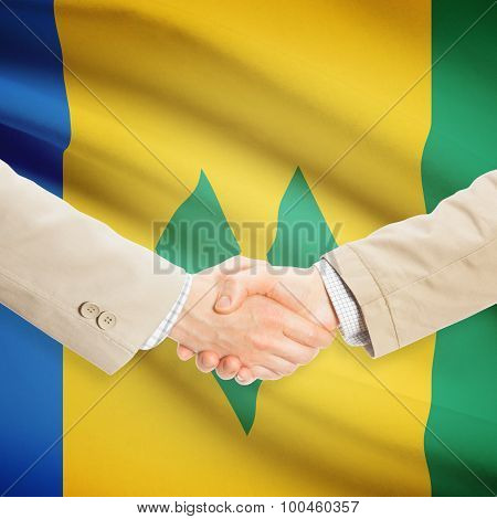 Businessmen Handshake With Flag On Background - Saint Vincent And The Grenadines