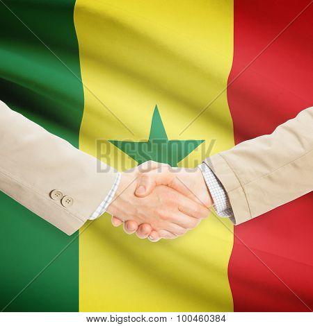 Businessmen Handshake With Flag On Background - Senegal