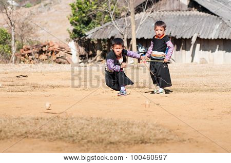 H'mong ethnic boys play traditional game in a festival in Mocchau, Vietnam