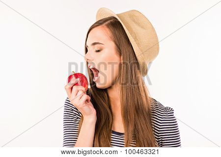Girl With Hat Biting An Apple