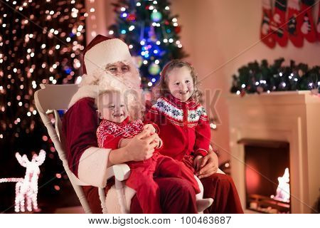 Kids And Santa At Fire Place On Christmas Eve