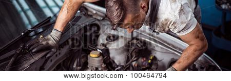 Automotive Technician At Work