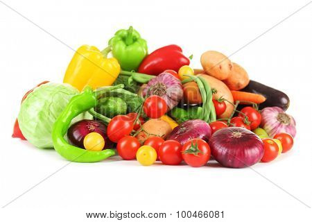 Heap of fresh vegetables isolated on white