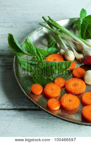 Fresh vegetables on meal tray on wooden table, closeup