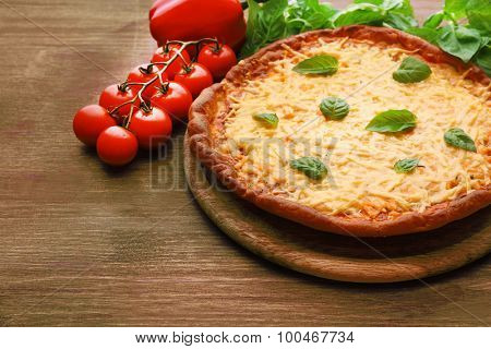 Cheese pizza with vegetables on table close up