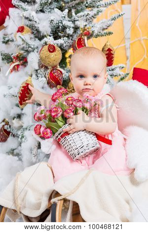 Little Girl With Gifts Under The Christmas Tree